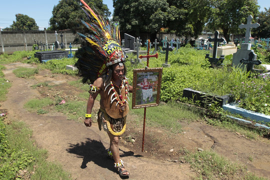 Ruiz, dressed in a native Indian costume, walks in the cemetery during the funeral of Chica Vaca, a popular cultural icon in Nicaragua, in Managua
