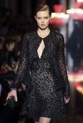 Model Lindsey Wixson presents a creation by Lebanese designer Elie Saab as part of his Haute Couture Fall/Winter 2014-2015 fashion show in Paris