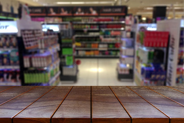 Empty wooden table space platform and blurred Supermarket aisle with product shelves background for product display