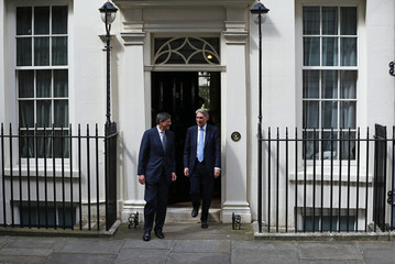 Britain's new Chancellor of the Exchequer Philip Hammond bids farewell to U.S. Treasury Secretary Jack Lew, at number 11 Downing Street in London