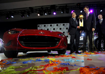 President of Mazda North American Operations Masahiro Moro holds up the trophy of World Car of the Year 2016 during an award ceremony at the 2016 New York International Auto Show in Manhattan, New York