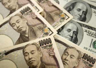 Japanese 10,000 yen notes and $100 dollar notes at the main office of the Korea Exchange Bank are seen in this picture illustration taken in Seoul