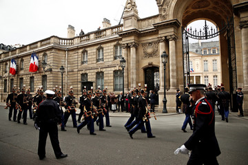 French Republican Guards arrive at the Elysee Palace before the handover ceremony between outgoing President Francois Hollande and President-elect Emmanuel Macron, at the Elysee Palace in Paris