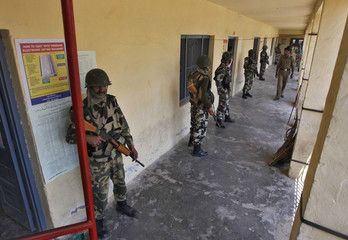 Indian security personnel stand guard at a polling station at Sopore