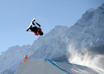 Snowboarder Sage Kotsenburg of the U.S. performs a jump during slopestyle snowboard training at the 2014 Sochi Winter Olympics in Rosa Khutor