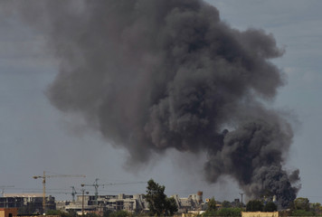 Smoke rises after a large explosion inside the city of Sirte