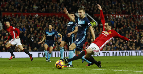 Manchester United's Henrikh Mkhitaryan in action with Middlesbrough's Ben Gibson