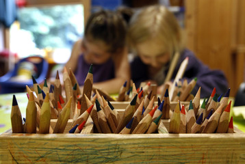 Coloured pencils are pictured in a wooden box at a nursery school in Eichenau