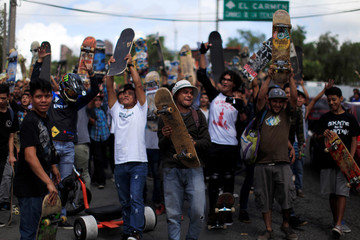 Skateboarders pose for a photo on Go Skateboarding day 2016 in San Salvador