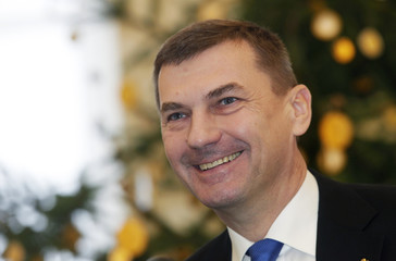Estonia's Prime Minister Ansip smiles during a news conference in Tallinn