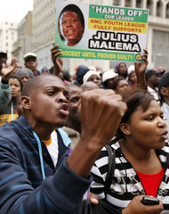 Supporters of African National Congress Youth League president Julius Malema chant slogans during his appearance at the Johannesburg court