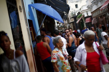 Tourists are seen on a street in Havana