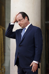 French President Francois Hollande waits for a guest at the Elysee Palace in Paris at the start of the Elysee Summit for Peace and Security in Africa, in Paris
