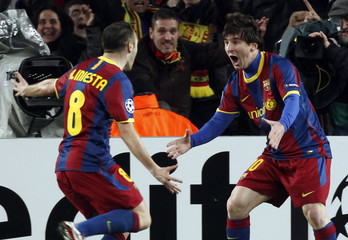 Barcelona's Messi celebrates with teammate Iniesta after scoring against Arsenal during their Champions League soccer match in Barcelona