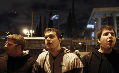 Supporters of the Greek Communist party shout slogans during a rally in front of the U.S. embassy in Athens