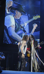 Steven Tyler and Joe Perry of Aerosmith perform during a concert on the first stop of their Latin America tour at the Jockey Club in Asuncion