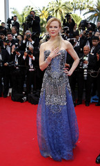 """Cast member Nicole Kidman poses on the red carpet as she arrives for the opening ceremony and the screening of the film """"Grace of Monaco"""" out of competition during the 67th Cannes Film Festival in Cannes"""