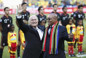 FIFA President Sepp Blatter speaks to Mexico's President Felipe Calderon during the opening ceremony before the 2010 World Cup opening match in Johannesburg