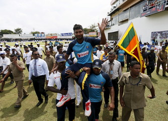 Sri Lanka's Sangakkara waves to his fans during his retirement ceremony after India won their second test cricket match against Sri Lanka in Colombo