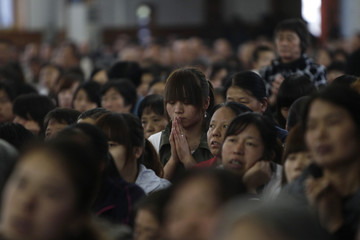 Worshippers attend a mass at the Liuhe Catholic Church on the outskirts of Qingxu county