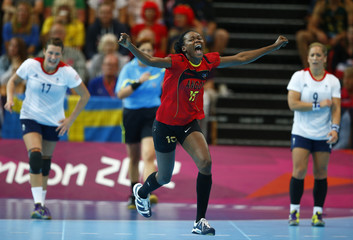 Angola's Azenaide Carlos celebrates a goal against Britain in their women's handball Preliminaries Group A match at the Copper Box venue during the London 2012 Olympic Games