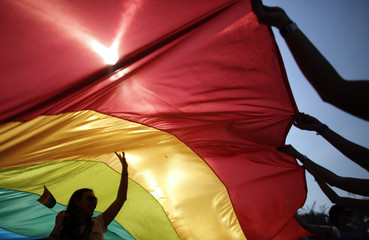 Activist walks underneath the rainbow flag during the fifth Sofia Pride annual parade in Sofia