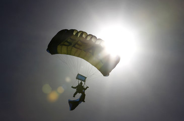 A U.S. Navy SEAL who is a member of the Navy parachute team 'Leap Frogs', takes part in a demonstration of combat skills at the National Navy UDT-SEAL Museum in Fort Pierce