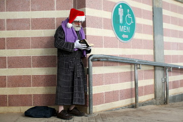 A man reads a book while waiting to participate in the Coney Island Polar Bear Club's annual New Year's Day swim at Coney Island in the Brooklyn borough of New York.