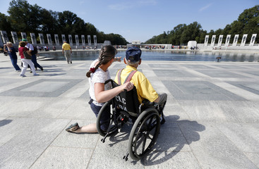 A veteran tours the World War Two Memorial in Washington
