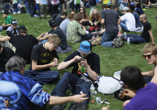 A man lights his pipe at the 4/20 pro-marijuana rally in Civic Center Park in downtown Denver