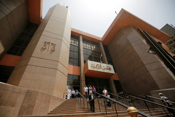 People walk at entrance of the State Council's building, Egypt's highest administrative court in Cairo, Egypt