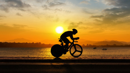 Man cycling at beach evening time