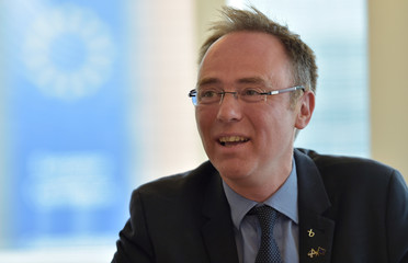 Scottish Europe Minister Allan talks to the media during a visit to Brussels