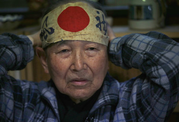 Japanese Katsumoto Saotome,  a survivor of Great Tokyo Air Raids in 1945, wears a headband on during an interview in Tokyo