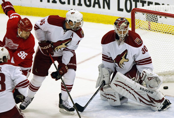 Red Wings leftwing Holmstrom watches as the puck goes in the net to score against Coyotes goaltender Bryzgalov and defensman Ed Jovanovski during the first period of Game 2 of their NHL Western Conference quarter-final hockey game in