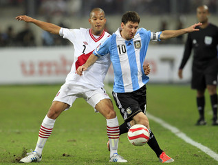 Argentina's Messi and Peru's Rodriguez fight for the ball during their 2014 World Cup qualifying soccer match in Lima
