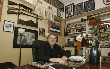 McDowell, retired after 30 years in the US Army, sits in his study with framed battalion patches from tours in Iraq and Afghanistan, in Columbia