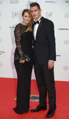 German national soccer player Klose and his wife Sylwia arrive for the Bambi 2014 media awards ceremony in Berlin