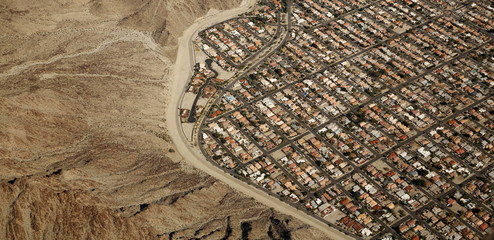 An aerial view shows a densely populated area abuts the desert in the Palm Springs area of California