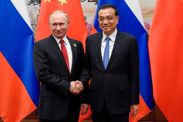 Chinese Premier Li Keqiang meets Russia's President Vladimir Putin at the Great Hall of the People in Beijing