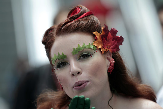 Attendee Breeze, who is dressed like comic character Poison Ivy, poses during Comic-Con convention in San Diego