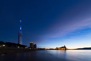 Illuminated Fukuoka tower and ocean in twilight  Wall mural