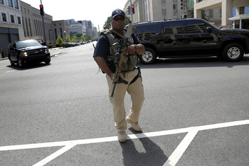 A U.S. Federal Marshal secures the streets outside the U.S. federal court in Washington