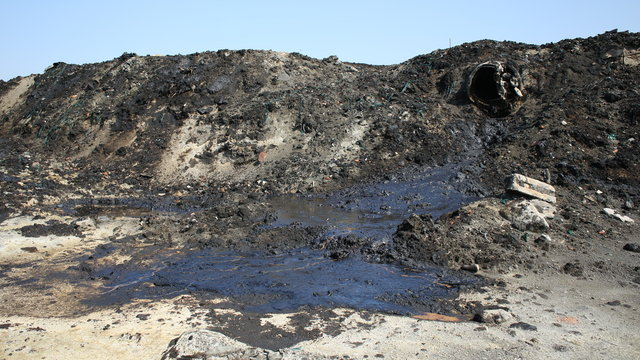 Former dump toxic waste, oil lagoon contamination. Nature effects from water and soil contaminated with oil and chemicals, environmental disaster, contamination of the environment, Moravia, Europe