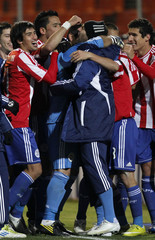 Paraguay's players celebrate after winning their semi-final soccer match against Venezuela in a penalty shootout at the Copa America in Mendoza