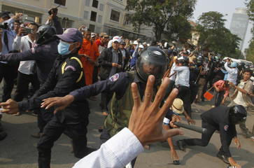 Protesters clash with security guards as they attempt to break through to Freedom Park in central Phnom Penh
