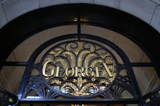 A logo is seen over the main entrance of the luxury hotel Four Seasons George V in Paris