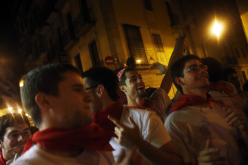 Revellers dance on the street before the fourth running of the bulls of the San Fermin festival in Pamplona