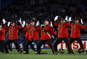 Members of the New Zealand Army Band perform the Haka during pre-match proceedings before the Rugby World Cup semi-final match between Wales and France at Eden Park in Auckland