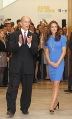 Britain's Catherine, Duchess of Cambridge is shown around by the Director of the National Portrait Gallery, Sandy Nairne, during her visit to the 'Road to 2012 : Aiming High' exhibition at the National Portrait Gallery in London